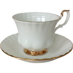 Royal Albert Val D'or White Bone China Teacup and Saucer with Gold Trim Perfect for a pre-wedding tea! White Tea Cups, Porcelain Ceramics, Fine Porcelain, White Ceramics, Vintage Cups, Vintage China, Vintage Dinnerware, China Cups And Saucers, Bone China Tea Cups