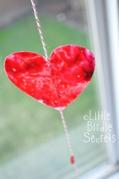Little Birdie Secrets: make crayon stained glass hearts with your kids {how to}