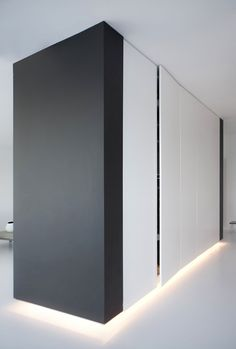 Closets with plinth lighting inside the Penthouse II in Copenhagen by Norm Architects.