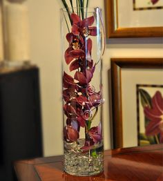 Purple Zensational Orchids...Zen is the art of reflection and meditation, and this striking flower arrangement of one tall purple cymbidium orchid stem – swathed in ti leaves and presented in a clear glass cylinder – is simplicity perfected. Stunning in a business setting, and equally lovely at home.   Beneva Flowers - Sarasota,FL
