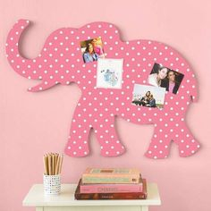 Just cover animal cutouts in girlie fabric to recreate a jungle theme for a little lady! Kids room