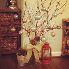 Rustic Christmas decor!  Love the pine cones in the vase