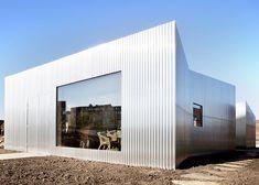 Aluminium-clad Rebel House by MONO reflects surrounding colours