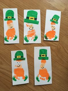 St. Patrick's Day footprint art. This is the perfect DIY craft to do with your children in order to commemorate the holiday.