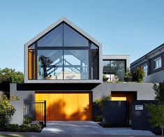 Gabled roof of architect-designed home with ramps for sausage dogs