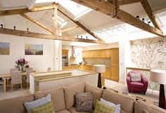 Renovated mews house in London exposes the roof structure in the top floor to house a light and airy kitchen/living room. Mews House, Roof Structure, Listed Building, Living Room Kitchen, Lancaster, Flooring, Architects, Chelsea, Buildings