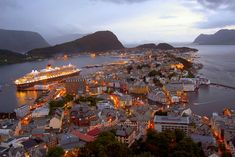 Alesund, Norway. I've always wanted to visit Scandinavia, and this would definitely be one of my stops. It's beautiful!