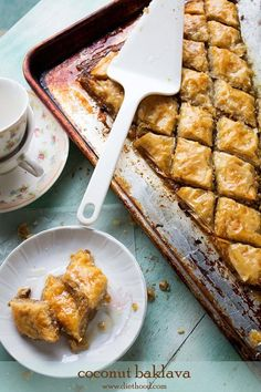Coconut Baklava | www.diethood.com | Layers of Phyllo sheets filled with a mixture of shredded coconut and walnuts |