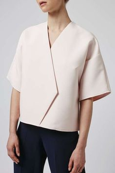 Add an edge to your staple wardrobe with this modern take on the classic wrap top. The kimono style top features a flattering wrap detail with a boxy shape that provides the perfect balance between cool and chic. By Boutique. #Topshop