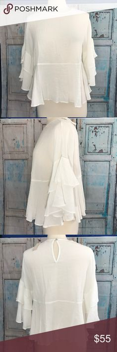 Eri+Ali White 3/4 Ruffle Sleeve Soft Pullover Top This flowy top has a classic neckline and a long ruffle sleeve. Its back  is buttoned up at the back as well. Great Festival top!  Measurements: Arm pit to arm pit: 18 in Length: 22.5 in Anthropologie Tops Blouses