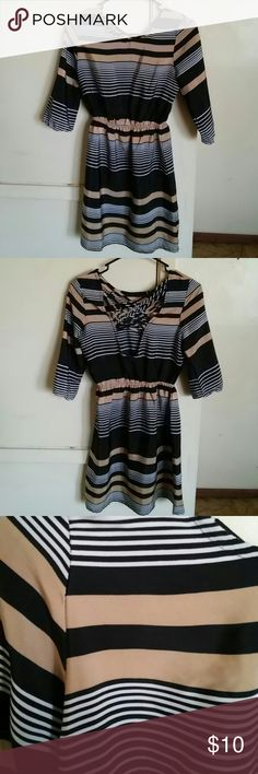 Fun and flirt 3/4 sleeve criss cross dress Knee length size xs Fun and flirt 3/4 sleeve dress with criss cross back detail and a cinched waist. Made out of silk like material and is very comfortable. Tan, white and black stripped pattern.In excellent used condition Dresses