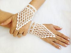 Beautiful crocheted gloves  http://www.ravelry.com/patterns/library/fingerless-crochet-lacy-wedding-gloves