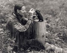 Conservationist Grey Owl presented himself as the son of an Apache and a Scot. He was in reality an Englishman who devoted much of his life to conservation. He is shown here with a beaver pup in Riding Mountain Park (courtesy Archives of Ontario/P-150). [note: Grey Owl lived in Riding Mountain National Park for a short time before moving to Prince Albert National Park.]