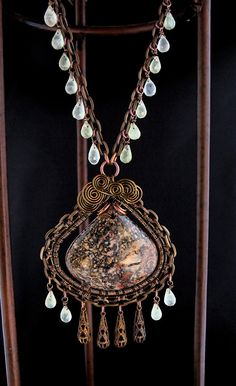 Brown, Green Stone Wire Wrapped Necklace - Vintaj Antiqued Brass. $115.00, via Etsy.