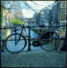 Fiets in Amsterdam.  Have seen this image in black and white with the fiets in oranje!