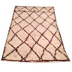 This vintage wool Beni Ourain Dane Rug is a lovely piece that would mix with a variety of styles.