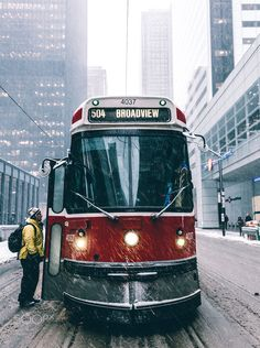 A person boarding a TTC streetcar in downtown Toronto during one of the very few snowstorms we had this past winter. Toronto Snow, Toronto Winter, Toronto Street, Toronto Ontario Canada, Downtown Toronto, Winter Landscape, Urban Landscape, Canadian Things, Toronto Photography