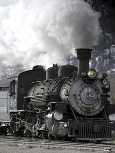 A Steam Train Puffing Smoke While Moving Down Tracks Photographic Print by Robbie George at AllPosters.com