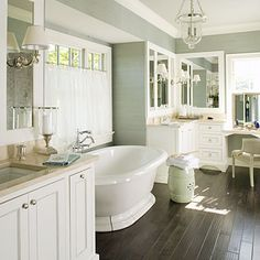Bring the relaxation home with a spa-inspired master bath. The master bath mixes crisp, polished pieces with textured grass cloth wall coverings and curtains to give it a warm spa-like feeling.