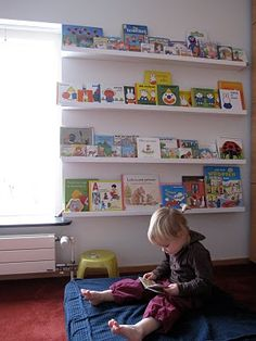 Great DIY book display...using IKEA Ribba picture ledges.