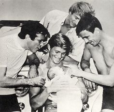 Chris dotes over Larry Casey's new daughter along with fellow Rat Patrol co-stars, Justin Tarr and Hans Gudegast, 1966-68.