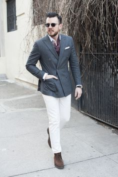 Shop this look for $206: http://lookastic.com/men/looks/double-breasted-blazer-and-pocket-square-and-dress-shirt-and-tie-and-chinos-and-desert-boots/2202 — Charcoal Wool Double Breasted Blazer — White Pocket Square — White Dress Shirt — Burgundy Embroidered Tie — White Chinos — Dark Brown Suede Desert Boots