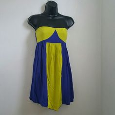 Strapless Green/Blue Short Dress Small Used a few times.  Size Small  Lime green and blue  Stretches on the back  100% rayon   **NO TRADES** **IF YOU DON'T LIKE THE PRICE PLEASE USE THE OFFER BUTTON** **IF YOU HAVE ANY QUESTIONS DON'T BE SHY TO ASK** Dresses Strapless