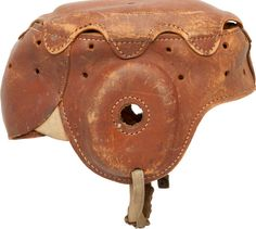 """1930's Princeton Style """"Spalding"""" Leather Football Helmet. Not a typical """"Princeton Style"""" helmet, such as the examples that feature a """"cap"""" stitched in four places, this leather """"Spalding"""" football lid presents a circa 1930's body with an attached eight-flapped top."""