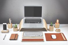 Maple Wood Grovemade Desk Collection with Maple laptop stand, pen cups, desk lamps, planter, leather mouse pad, leather wrist pad, and keyboard tray.