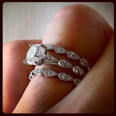 Engagement ring and wedding bands by Jeff Cooper. Via Diamonds in the Library.