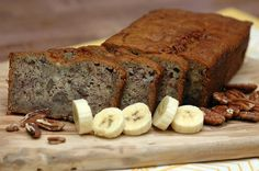 Banana Bread -  fine art food photography -  warm sliced banana bread with pecans on a cutting board . 8x10