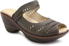This sporty 2½ inch wedge is a beautiful shoe. It has a Velcro strap that crosses over the middle of the foot and allows the wedge to be fastened in the most comfortable position for your foot. It's simple, but stylish cutouts on the upper, made of nubuck leather, as well as the floral motif on the midsole allow for a feminine look.