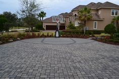 Lucky kid! cool basketball court out of pavers.