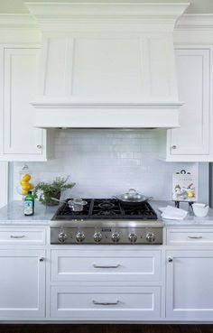 via Hendel Homes - a white kitchen with a classic white subway tile backsplash and a sleek Thermador range cooktop. Kitchen Redo, Kitchen And Bath, New Kitchen, Kitchen Remodel, Kitchen White, Kitchen Ideas, White Kitchens, Classic White Kitchen, White Subway Tile Backsplash