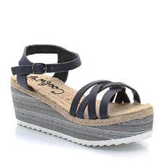 Sandales en cuir, talon compensé imprimé, bout ouvert, Garric de Coolway.Dessus : cuir (vachette)Doublure : non doubléSemelle intérieure : JuteSemelle extérieure : caoutchoucHauteur de talon (compensé) : 7 cm environ. Fermeture: bride à boucle réglableToujours à la pointe de l'actualité, Coolway, la célèbre marque espagnole, nous offre une belle sandale compensée trendy.