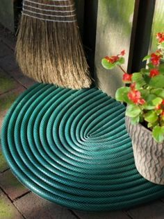 Upcycle an otherwise landfill destined hose into a door mat.