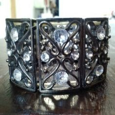 *$10 Sale!* Silver Rhinestone Stretch Bracelet Silver metal bracelet with rhinestone details. Exposed elastic on interior. In great condition! Silver rectangles are 1.25 inches tall. Diameter of bracelet is 2.25 inches. Please ask any and all questions before purchasing. No trades. Make a reasonable offer. Thanks! Boutique  Jewelry Bracelets