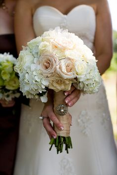I think this is a very beautiful bouquet. The flowers look soft and pretty. I don't like the wrapping around the flowers that much. It looks a little simple to me. The pin is nice though-I like pearls.