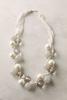pearls and ribbon looks easy to make. Just find beads with bigger holes or really thin ribbon!