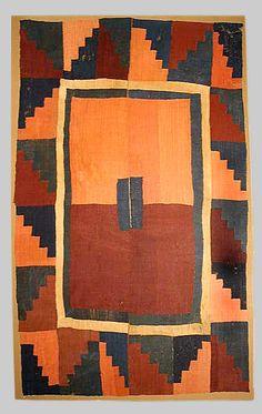 "A pre-Columbian Cushma style tunic of burgundy and tangerine.  Camelid fibre Dimension: Length 82""(208cm) x Width 55""(139cm).  Nazca valley, south coast ofo Peru, c. 400-600A.D."