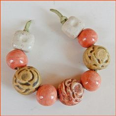 Set of 9 beads stoneware and porcelain. They have cream…