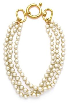 A big, fat pearl necklace by Fallon that really sells the golf pro's girlfriend thing—and looks appealing out-of-place on the floor of a Winnebago.