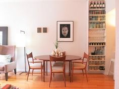 Kitchen storage in the dining area of a studio apartment