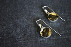 Real butterfly wing earrings set under resin in sterling silver. Butterfly jewelry