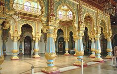 Mysore, Palace interior. natural cooling to the interiors. The ground flooring is made of a special mixture of secret spices, herbs, mixed in Lime and plastered over Granite stones, that helps to retain the coolness.