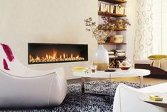 """The #Focus #Neofocus is wide screen entertainment – creating warmth and atmosphere.  Purity of design and utter simplicity – the Focus Neofocus lends timeless #elegance to the home. This perfectly proportioned, """"wide-screen"""" built-in #fireplace takes pride-of-place in the living room."""