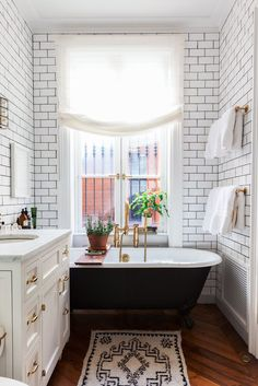 """""""I feel like I chose brass fixtures before it became everywhere, and yet I'm sure they were in the air before; it was in my psyche somewhere. I love a chunky fixture."""" — Alison Cayne The freestanding claw-foot tub was chosen because it felt romantic."""