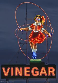 The Skipping Girl Sign or Skipping Girl Vinegar Sign, colloquially known as Little Audrey, is the first animated neon sign in Australia. The sign is located at 651 Victoria Street within the inner Melbourne suburb of Abbotsford. Old Neon Signs, Vintage Neon Signs, Old Signs, Neon Licht, Melbourne Victoria, Victoria Australia, Roadside Attractions, Roadside Signs, Googie
