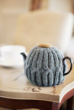 this tea cozy pattern is so simple and lovely. i'm tempted just to copy-from-sight, but I think I'm going to buy the pattern because: after all: I'd want someone else to buy it if it were me! (want one, @Heather Arndt Anderson? I owe you a handmade thing... and this could be knit on the airplane next week!)
