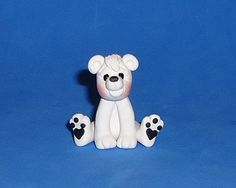 Hey, I found this really awesome Etsy listing at http://www.etsy.com/listing/105606042/polymer-clay-polar-bear-sitting